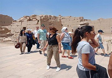 The Minister of Tourism wanders around the Scarab...